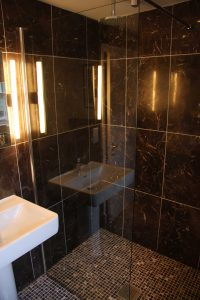 A walk in shower room with marble tiling modelled using BIM software